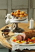 Chateaubriand with a gingerbread crust served with dried plums and croquettes