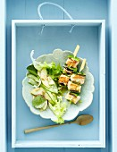 Salmon skewers with a peach and cucumber salad