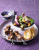 Cinnamon lamb skewers with a chestnut and mushroom salad