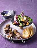 Cinnamon lamb skewers with a chestnut and mushroom salad
