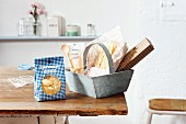 Home-made pasta in a bag and in a wooden basket as a present