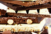 A stack of various different chocolate bars (detail)