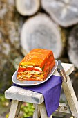 Ratatouille in aspic on a stool outside
