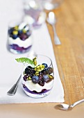 A layered dessert with white chocolate mousse, blackberries and blueberries