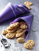 S-shaped, pipped vanilla biscuits in purple cones
