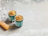 Homemade espresso ice cream sticks in cups