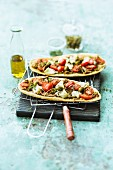 Unleavened bread pizzas with date tomatoes and goat's cheese
