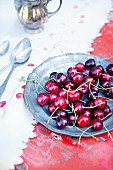 Fresh cherries on a pewter plate