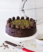 Chocolate cake decorated with Mozart pralines
