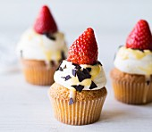 Egg nog cupcakes with strawberries and cream