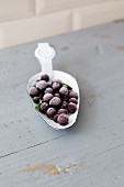 Frozen blackcurrants on a spoon
