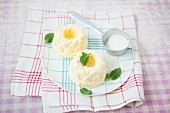 Mini mango parfait Bundt cakes with mint leaves and grated coconut