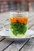 Herbal tea with marigold and verbena in a tea glass