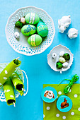Easter eggs, napkins and boxes with Easter bunny pictures