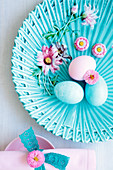 Easter eggs on a turquoise plate (seen from above)