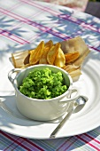 Mushy peas with potato wedges