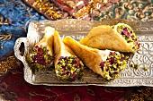 Quataif (stuffed pancakes, Arabia) with pistachios