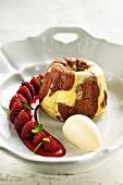 Warm marble pudding with marinated raspberries and vanilla ice cream