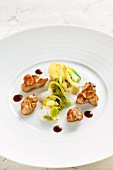Veal shortbread with citrus fruits, nuts and young celeriac