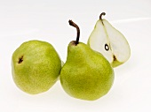An arrangement of pears, one halved