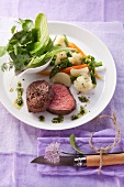 Beef fillet with green sauce and vegetables