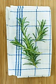 Rosemary sprigs on a tea towel