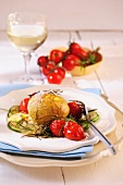 Oven baked tomatoes with potatoes and courgette medley