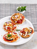 Mini pizzas topped with lentils