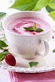 Strawberry soup with mint leaves