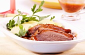 Roast goose breast with gravy and potatoes