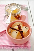 Pear compote with cloves and cinnamon sticks