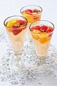 Champagne cocktails made with tonic water, oranges and strawberries