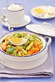 Couscous salad with green and yellow beans, eggs and dried apricots