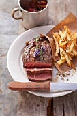 Rib-eye steak with herb chips