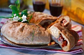 Bread stuffed with dried tomatoes, mozzarella and ham