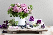 Bouquet of scented roses and scented pelargoniums surrounded by sweet peas and blueberries