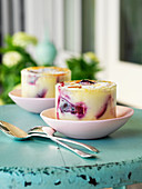 Plum and ricotta vanilla flans