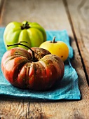 Heirloom tomatoes on a blue cloth
