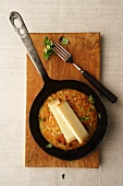 Hash browns with gruyere in a pan