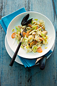 Pasta salad with mussels, carrots and leek