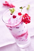 A layered yogurt dessert with redcurrants