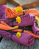 Rolled up napkins decorated with flowers