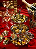 Various canapes on a cake stand