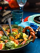 A salad with sweet potatoes, spinach and exotic fruits (Caribbean)