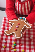 A child showing a gingerbread man