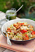 Tagliatelle with wild mushrooms, tomato, ham and pesto