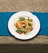 Linguine with prawns, spinach and sheep's cheese