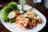 Som tom (Thai salad with green papaya, carrots, chillis, string beans)