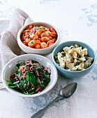 Warm spinach salad with lentils, mashed potatoes with olives and white beans in tomato sauce