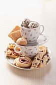 Assorted cookies on a cake stand made of coffee cups